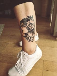 Traditional girls face ankle tattoo