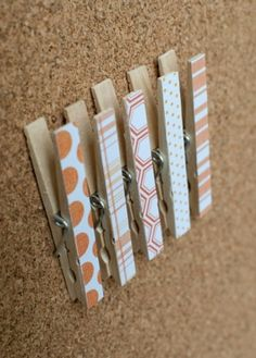 Clothespins with pushpins attached to the back. No more holes in the pictures on my bulletin board! by mom2halie