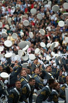 West Point Cadets toss their hats into the air at the completion of the 2014 graduation ceremony at the United States Military Academy, West Point, N.Y., May 28, 2014. (U.S. Army photo by Sgt. Mikki L. Sprenkle/Released) #USArmy