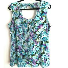 Roz & Ali Turquoise Floral Bow Back Top 1X This Roz & Ali (Dress Barn) Turquouse Floral Bow Back Top is a size 1X in great used condition. Colors include turquoise/aqua, purple, pink & White on 95% polyester, 5% spandex (stretchy) fabric with an asymmetric overlay and bow across the back. Bust measures 22 inches across laying flat, measured from pit to pit unstretched, so 44 inches around. 28 inches long. ::: Bundle 3+ items from my closet and save 30% off when you use the app's Bundle…
