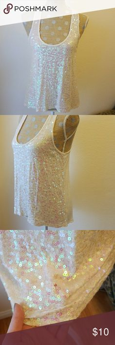 Sequin Tank Top SUPER CUTE sparkly sequin top. SMALL hole towards the bottom. Easily fixed. Cream color. Good condition otherwise! Tops Tank Tops