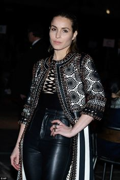 Flair for fashion: Dressed in an eye-catching black and white pinstriped jacket, the Swedish beauty clearly pulled out all the stops to remain the centre of attention