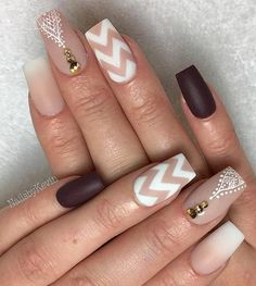 Very nice nude color enriched with dark red color. White details and gold rhinestones are very nicely composed in all manicure.