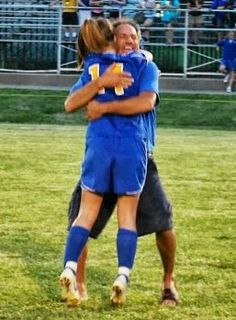 A hug for the proud Soccer Dad!