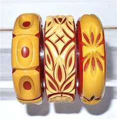 Cast carved butterscotch and red bakelite bracelets.