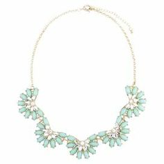 """Add a pop of style to evening ensembles and work outfits alike with this stunning gold-plated necklace, showcasing a bib of floral-inspired beading highlighted by shimmering rhinestones.   Product: NecklaceConstruction Material: Zinc alloy, resin and rhinestonesColor: Teal and goldFeatures:  Adjustable chain length adds up to 3""""Floral-inspiredHandmade   Dimensions: Chain: 21""""Stones: 1.85"""" H x 9"""" WCleaning and Care: Avoid all oils and chemicals (such as lotions, hairspray, makeup and ..."""