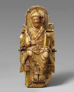 Pectoral with Christ and the Lamb of God and the Symbols of the Four Evangelists  Date: 1000–1050 Geography: Made in, near Saint-Omer Culture: English or North French Medium: Walrus ivory with gilt-copper sheets and copper alloy pin