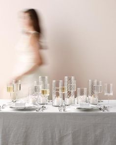 Connect the Dots  Using simple paper stencils, transfer the patterns or table numbers to vases with a couple of coats of Rust-O leum Specialty Frosted Glass Aerosol Paint (homedepot.com). Then place small pillar candles inside.