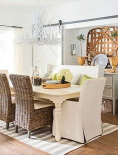 A painted twig chandelier punctuates the nature theme in the dining area. More photos from this Door County cottage: http://www.midwestliving.com/homes/featured-homes/house-tour-budget-savvy-dream-cottage/?page=1