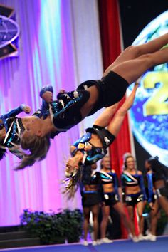 Maryland Twisters twisting! :) cheer competition cheerleader cheerleading in the air, competitive