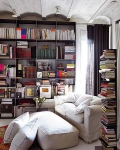 At first I thought the books on the right were just stacked there, despite all the wonderful shelves in the background. I now realize they are carefully stacked there, probably on shelves. But the point is the same - for book lovers, no amount of shelves ever seem to be enough :)