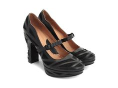 A friend just introduced me to Fluevog and now I'm lusting after several of them, including this Sharanpal shoe.