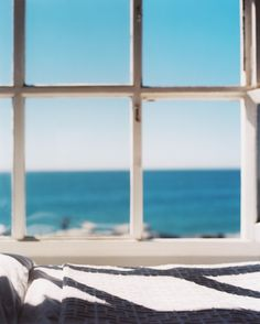 Views of the ocean through a bedroom window