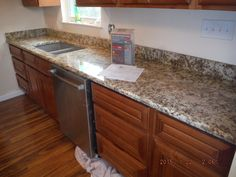 Giallo Napoli granite kitchen install for the Bosse family. Knoxville's Stone Interiors. Showroom located at 3900 Middlebrook Pike, Knoxville, TN. www.knoxstoneinteriors.com. FREE Estimates available, call 865-971-5800.