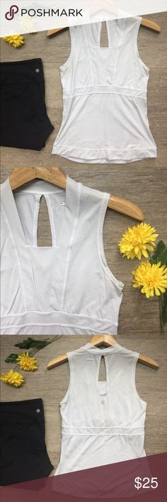 """Lululemon Striped Tank 🌼 Lululemon white and gray striped tank.  Features cute fitted cut in front and keyhole in back.  One small light gray spot on back and slight discoloration in armpits.  Not noticeable unless looking closely.  No size tag so check measurements.  Chest is 30"""" and length in front is 23"""" and in back is 24"""". lululemon athletica Tops Tank Tops"""