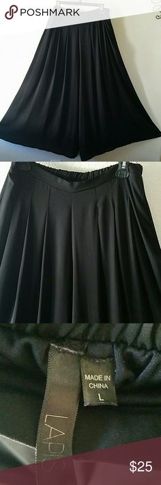"""SALE ❣Lapis Flare Pants❣ Lapis beautiful black flare pants. Gently used. In good condition. No damages. Partial elastin waistband. Approx L 42.5"""". Lapis Pants"""