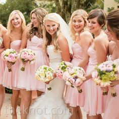 Bridesmaids in light pink dresses with pink and green bouquets {via theknot.com} - view the whole apple-green and light pink colour scheme at http://themerrybride.org/2014/03/20/apple-green-and-light-pink-wedding/