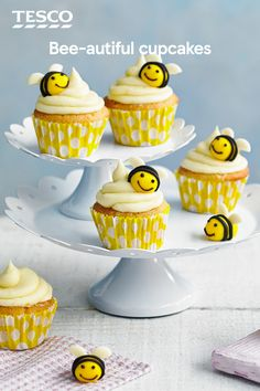 Not just for kids, these dainty bee cupcakes are super cute, and super tasty, too. Studded with white chocolate chips and given a fresh lift with orange zest, you can indulge your creative side with the sweet icing bumble bee decorations. | Tesco