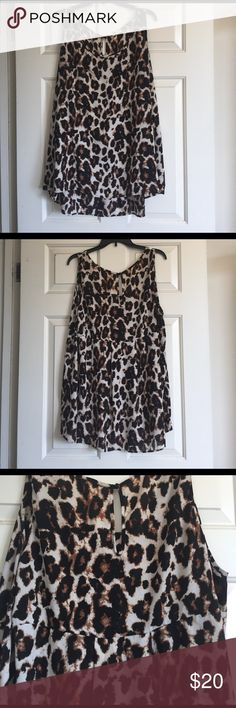 Animal Print Tank Top Blouse - Plus Size Animal Print Tank Top Blouse - Plus Size. Great work or a night out! I used to wear a black belt with it to cinch my waist a little bit. Looks chic with a black cover up or blazer. There's a small thread pull (pictured) but not really noticeable. Cheetah / leopard. Brown, black, cream, white. Pleione Tops
