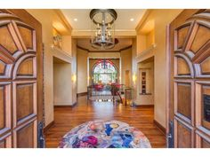 Majestic Italian stone villa designed by Smuckler, nestled on priv one acre Indian Hills woodland setting. Soaring interior volume, private owner's wing, elevator, paneled library, two saunas & walkout family/AR room.  #edina #minnesota #realestate #beautifulhomes