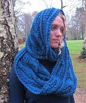 A richly textured reversible cowl wrap with cables and stitch patterns inspired by climbing leaves.