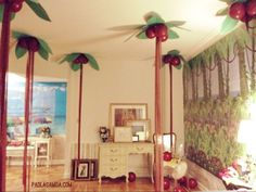 Jungle Trees (made with crepe paper trunks, paper leaves, and balloon coconuts)
