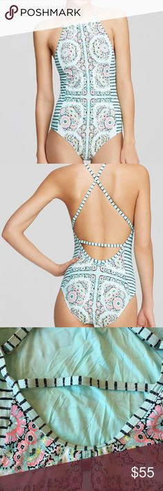 Nanette Lepore Montecito One Piece Swimsuit Sz M **EUC, just a little wrinkly from being in my drawer**  Striped side panels lend a slimming effect to this Nanette Lepore one-piece that's lush with geometric blooms.  -High neck; adjustable shoulder straps; printed -Crisscross open back with horizontal strap; shelf bra with built-in cups -Polyester/elastane -Hand wash -Made in USA of Imported Materials -Web ID: 1338198 Nanette Lepore Swim One Pieces