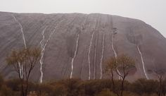 Uluru's magnificent waterfalls: landmark transformed by rain – in pictures