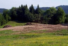 On the right is a similar view of the site of Göring's house, taken in 2001 before the construction of the hotel on the hilltop. The circular water filled depressions in the center and right foreground are bomb craters remaining from the April 1945 attack. The hotel construction has radically changed this site - the view below from a similar perspective was taken after the hotel construction.