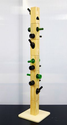 """This design by Daniela Cruz puts old bottles to use, repurposing them as """"hooks"""" you can hang your jacket or coat on"""