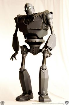 """ca-tsuka:  Preview of """"The Iron Giant"""" toy by Mondo.The Iron Giant Collectible Figure The 16"""" tall figure will have over 30 points of articulation, light features, and other fun surprises! Accompanying The Iron Giant will be a Hogarth figure, scraps of metal for him to munch on and a Seafood sign that has a removable """"S"""" to put on his chest. He will also include an interchangeable head and gun attachment, giving a choice of displaying the figure as the regular version, or the """"War"""" version…"""