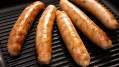 Salmon and Haddock seafood sausages from Kilmore Quay on a grill.