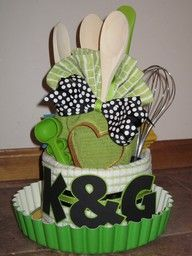 a wedding spin on the diaper cake. Make it full of home things for the newlyweds! - got a cousin getting married next month!