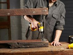 Combine+reclaimed+wood+and+galvanized+black+pipe+to+create+a+rugged+bookshelf+that+adds+texture+and+warmth+to+any+room.+Get+the+step-by-steps+on+HGTV.com.