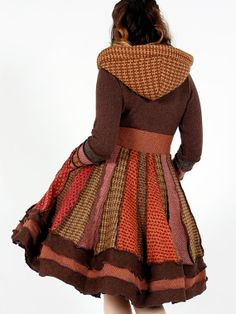 A cloak like this but in red and with the laces tied on the back. Also with fewer different fabrics...