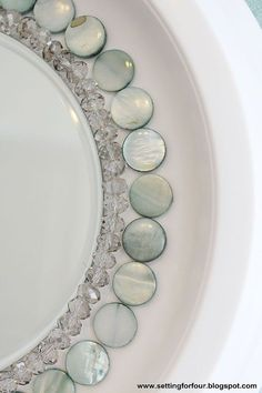 diy beaded sunburst mirror from a ceiling medallion scrapbook paper, crafts, diy, home decor, how to, wall decor, These mother of pearl blue beads and clear faceted beads give such an elegant sparkle and touch of color to my room