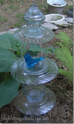 """Bluebird of happiness"" totem. Made with assorted glassware (thrift store or old unused vases) and silicone caulk. Other ideas for glass totems too."