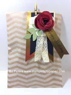 February 14, 2014 Going for the Gold! | Tag a Bag Gift Bags; Banners Framelit; Spiral Flower Die; Paper: Gold Foil Sheet, Basic Black, Very Vanilla, Cherry Cobbler, Pear Pizzaz; Accessories: Mini Metallic Clothespins, Secret Garden Framelits, Crochet Trim, Deco labels framelits; Stamp Set; Remembering Your Birthday
