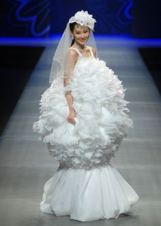 Ugly Wedding Dresses You Won't Believe People Wore:  Poofy - Usually the puffy part comes at the bottom of the dress. This is almost like a reverse dress. It does have one thing going for it, though, it sure looks good to take a nap in.