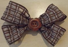 Hair bow brown in color with a flower by Deannaroserichardson, $2.00