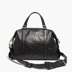 Yes, this is the go-anywhere bag you've been looking for. Made of rich leather in a deceptively compact size (trust us, it can hold all your haul-it-around-daily supplies), this duffel-inspired design has both handy top handles and a sturdy shoulder strap. Finished with our signature collar stud closures, this is one you'll have in your life for a long, long time—it's pretty much a shortcut to polish.Please note: As leather is a natural material, each bag varies slightly in texture and…