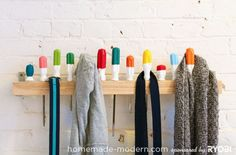 DIY Screwdriver clothing rack -- have fun with pops of color on white! Scout out used tools at second hand stores or estate sales to keep your cost low.