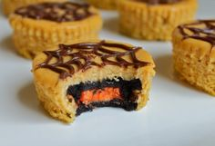 Halloween Oreo Pumpkin Cheesecakes - so cute! I am always looking for fun Halloween food ideas!