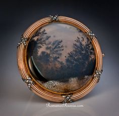 A Faberge rose gold and moss agate antique Russian brooch by head workmaster Henrik Wigstrom.