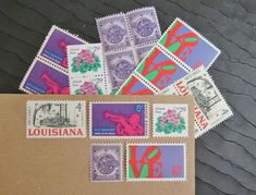 Love these postage stamps with Louisiana & African Violets. May get them just to collect. (tbb)