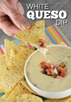 Just like you get at your favorite Mexican restaurant - this White Queso Dip Recipe is creamy and delicious! Serve as an appetizer or as a side with your favorite Mexican meal!