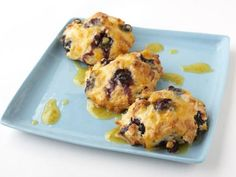 Orange Glazed Blueberry Scones: Fold fresh blueberries into buttery batter for a flaky brunch treat. Once they're cool, Tyler Florence finishes each scone with a sweet-tart orange glaze.