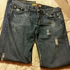 Low waist boy-cut jeans--distressed These are a size 4 short. They are better for medium to short legs. They are comfy and flattering without hugging the body too much. Pants