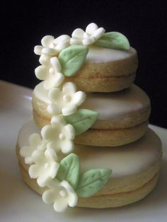 Mini wedding cakes.  Stacked butter cookies with royal icing, chocolate and sugar paste flowers.