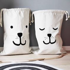 Canvas drawstring laundry bag with adorable washing machine design printed in black. Beyond cute! Size:Length 64.5 cm X Width 44.5 cm Machine Washable